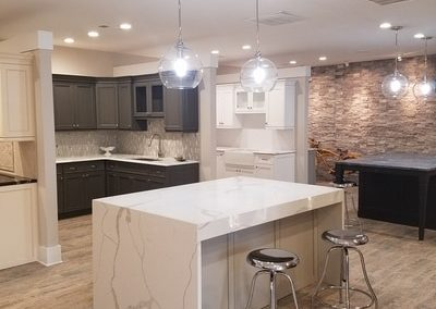 """This is a """"waterfall island"""". The marble is perfectly seemed so that the grain is un-hindered. All sides are white marble, the cabinets inside the waterfall are Wysocki Brothers, its a grey finish as well. This is in the Kitchen and Bath Showroom in Kennesaw Georgia - Cobb County"""