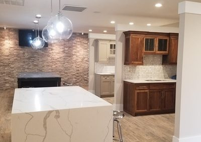 "This is a ""waterfall island"". The marble is perfectly seemed so that the grain is un-hindered. All sides are white marble, the cabinets inside the waterfall are Wysocki Brothers, its a grey finish as well. This is in the Kitchen and Bath Showroom in Kennesaw Georgia - Cobb County"