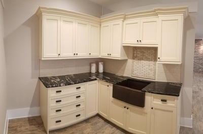This is cream colored custom finished cabinetry by Wysocki Brothers Remodeling Marble Counter