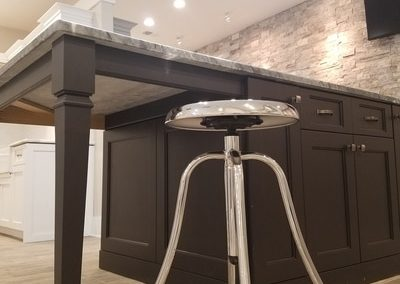 Kennesaw kitchen and bath showroom. Showroom featuring custom cabinetry by Wysocki Brothers . Custom Island with honed marble finish. The honed finish is matte instead of shiny. We have several kitchen islands on display in the showroom.