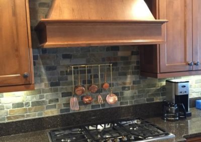 This is a stone back splash and our own hand finished custom Wysocki Brothers Cabinets, and granite counters...we LOVE this color combination