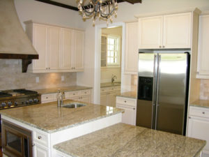 white kitchen cabinetry granite countertops
