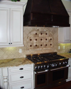 white kitchen cabinetry granite countertops stone backsplash