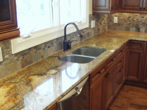 granite countertops hand finished custom cabinets with stone backsplash and granite tops